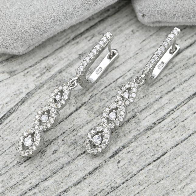 Срібні сережки темні камені розмір 35х6 мм вставка білі фіаніти вага 5.9 г